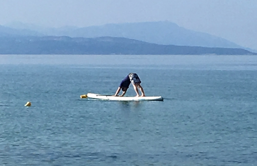 Stand up paddle board Downward Dog